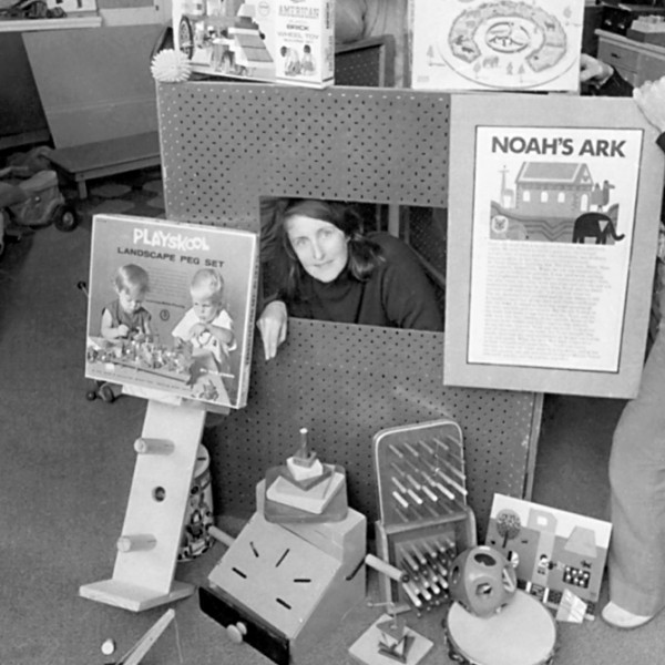 """Black and white image of founder Annetine Forell with Noah's Ark toy display"""